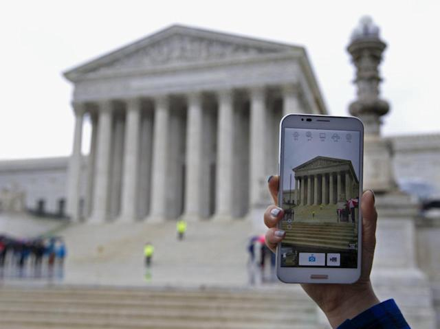 A person outside of the Supreme Court in 2014, when it heard arguments in the cellphone privacy case Riley v. California. Jose Luis Magana/AP