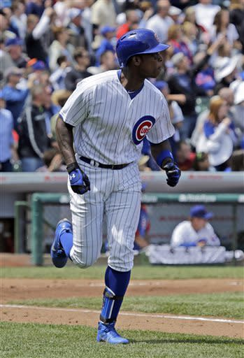 Chicago Cubs' Alfonso Soriano runs up the first baseline after hitting a two-run home run during the third inning of a baseball game against the Cincinnati Reds in Chicago, Saturday, May 4, 2013. (AP Photo/Nam Y. Huh)