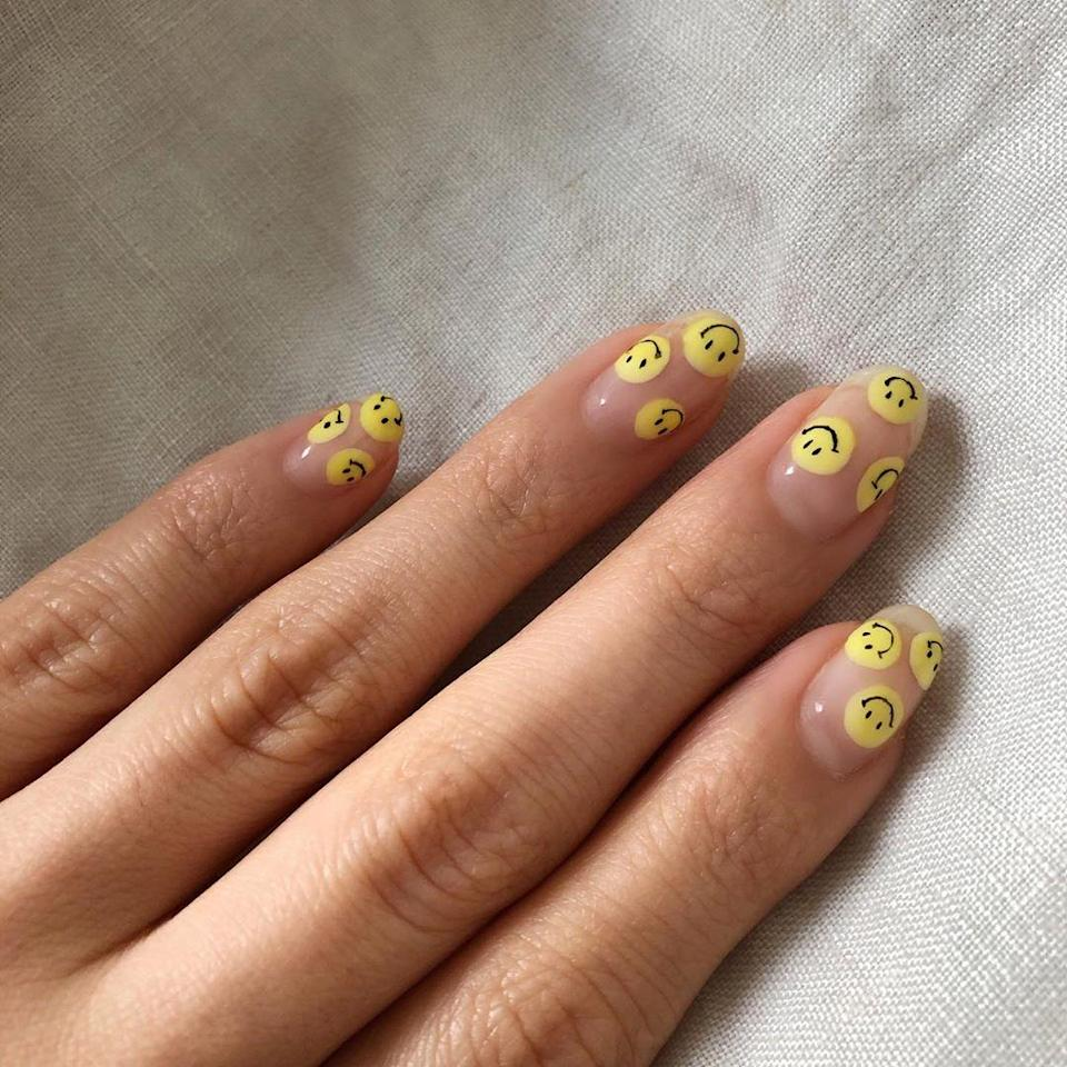 "Smiley faces have become the surprise celeb favorite this year, and have been spotted on everyone from Dua Lip to Harry Styles. To get the look without a trip to the salon, try <a href=""https://us.ciatelondon.com/products/stick-on-nail-stickers"" rel=""nofollow noopener"" target=""_blank"" data-ylk=""slk:these stickers"" class=""link rapid-noclick-resp"">these stickers</a> from Ciaté London."