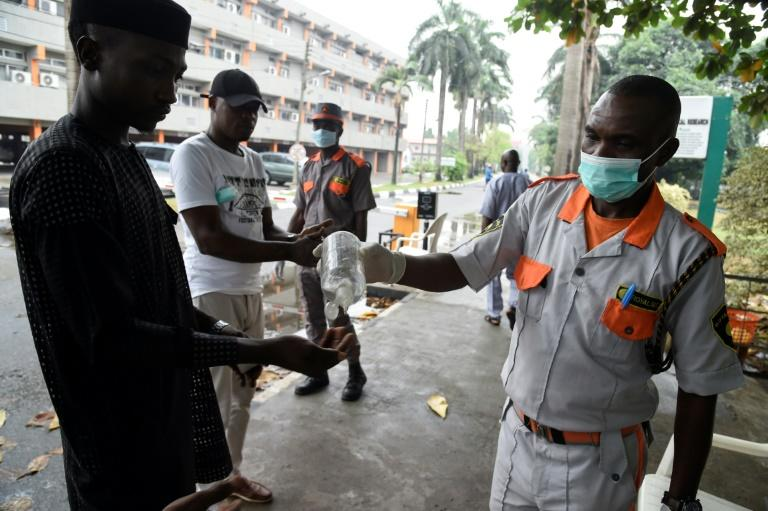 Hand hygiene: A visitor uses sanitisation gel before being allowed into a state hospital in Lagos
