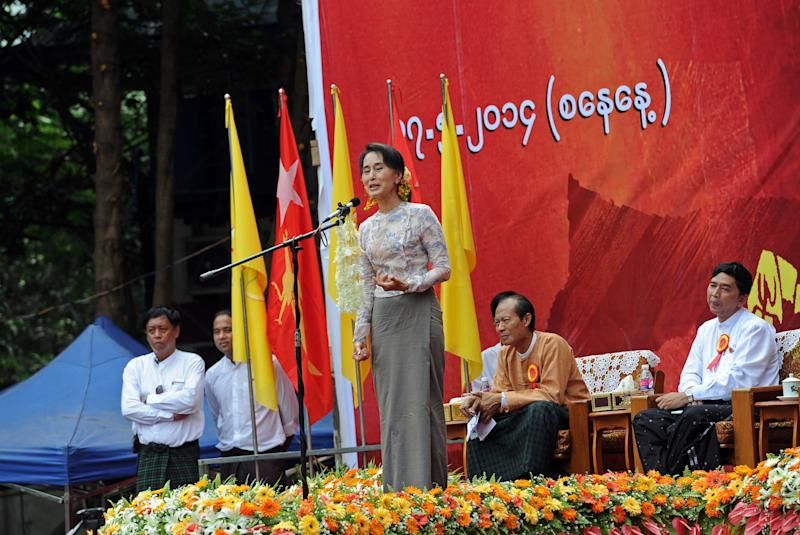 Aung San Suu Kyi speaking during a joint public address with 88 Generation Students in Yangon on July 17, 2014, she is calling for a change to Myanmar's constitution