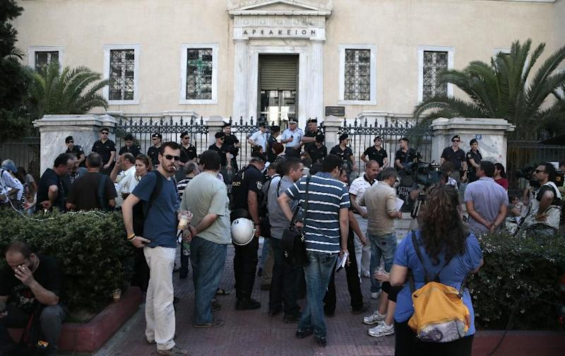 Fired employees of the Greek state broadcaster ERT are protesting outside a high court that convened to consider union objections to the closure of broadcaster ERT in Athens on Thursday june 20, 2013 ahead of talks by the troubled coalition government on restarting the station's transmissions. Conservative Prime Minister Antonis Samaras is due to meet center-left coalition partners for a third time this week to decide on the fate of the future public TV and radio company and its nearly 2,700 employees, which it closed down nine days ago. (AP Photo.Dimitri Messinis)