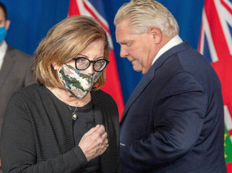 Ontario's associate chief medical officer of health Dr. Barbara Yaffe passes Premier Doug Ford at a press conference in Toronto Jan. 8, 2021.  (Photo: Frank Gunn/Canadian Press)