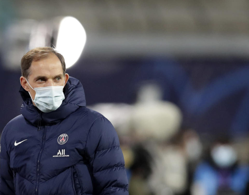 FILE - In this file photo dated Wednesday, Nov. 4, 2020, PSG's head coach Thomas Tuchel looks on during warm up before the Champions League group H soccer match against RB Leipzig at the RB Arena in Leipzig, Germany. Thomas Tuchel is confirmed as the new Chelsea soccer team manager, Tuesday Jan. 26, 2021.(AP Photo/Michael Sohn, FILE)