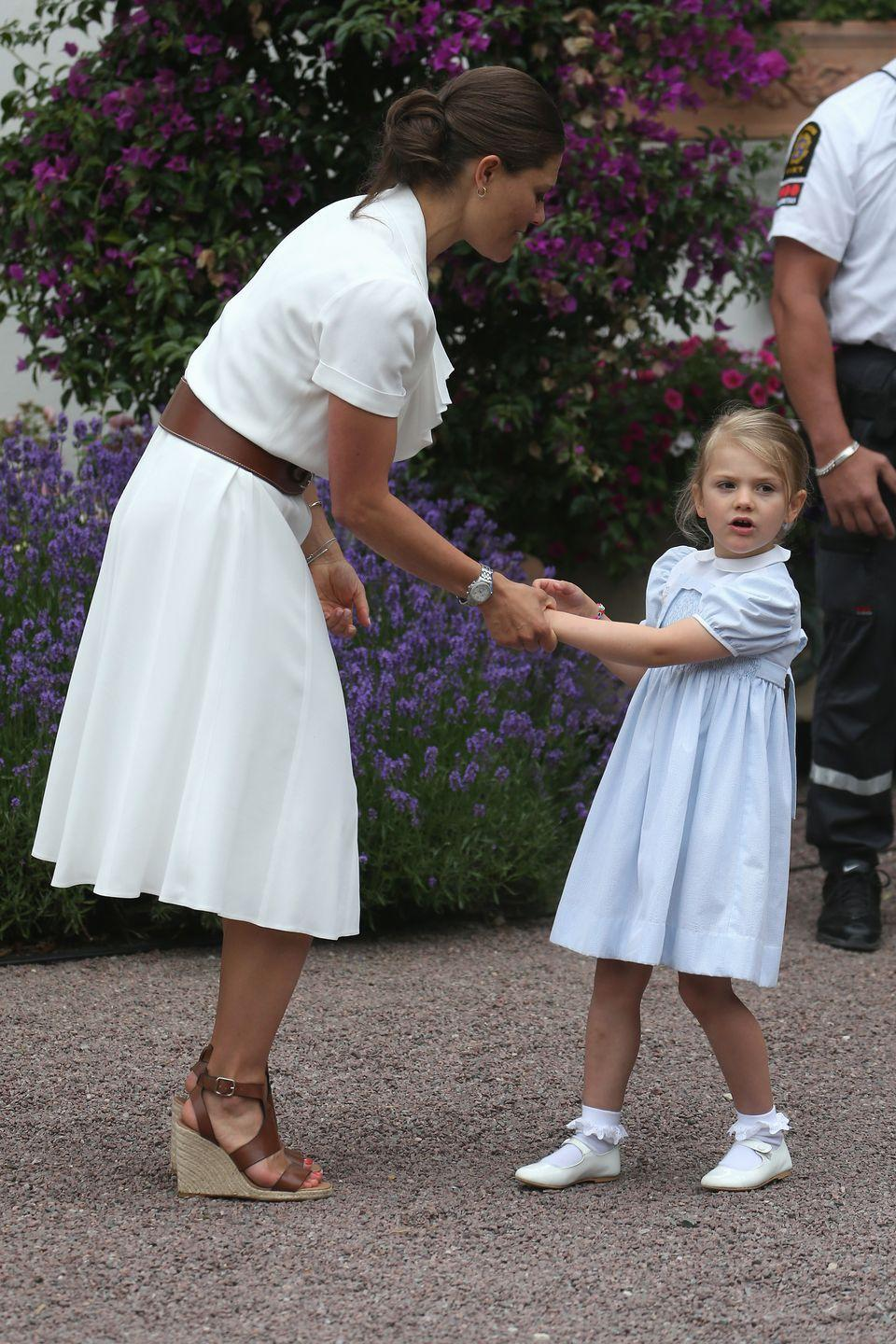 <p>The 42-year old is pictured here with her daughter, Princess Estelle, wearing a summery dress by Ralph Lauren. </p>