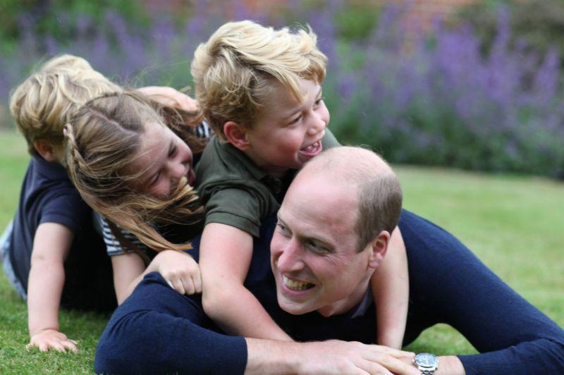 Another shot also showed the royal dad playing with his kids in the grounds of Anmer Hall in Norfolk (Getty Images)