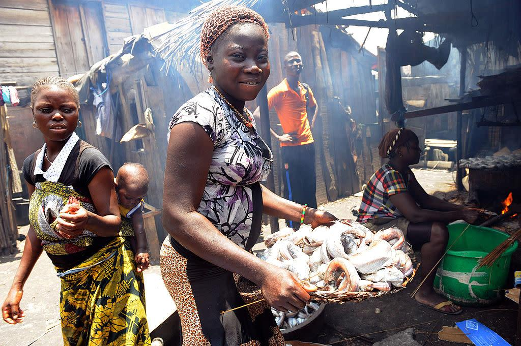 A girl carries smoked fish at Makoko shanty town in Lagos on Aug. 30, 2012.   PIUS UTOMI EKPEI—AFP/Getty Images