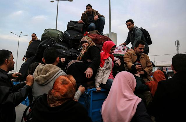 <p>Palestinians in Gaza wait for travel permits to cross into Egypt through the Rafah border crossing after it was opened by Egyptian authorities for humanitarian cases, Feb. 7, 2018. (Photo: Mohammed Saber/EPA-EFE/REX/Shutterstock) </p>