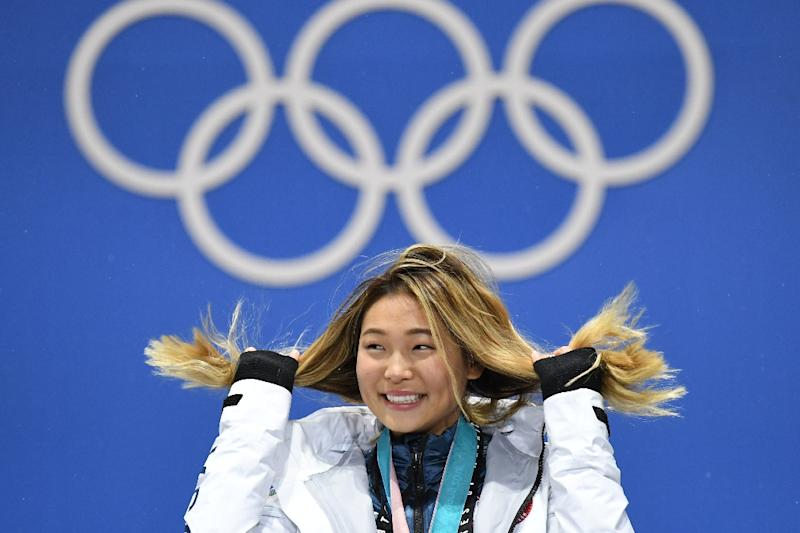Tales of how USA gold medallist Chloe Kim's biggest fan -- her Seoul-based grandmother -- boasts about Chloe's exploits over tea to her fellow church-goers melted hearts (AFP Photo/Kirill KUDRYAVTSEV)