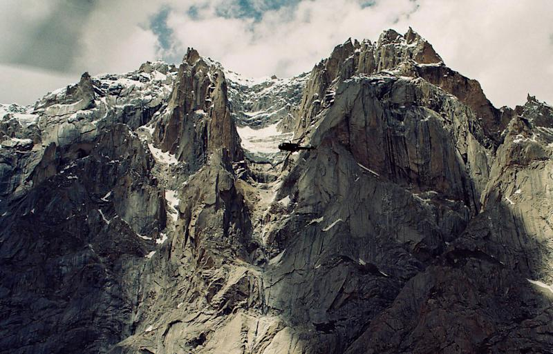 FILE - In this May 2003 file photo, an army helicopter flies over the Siachen Glacier on Pakistan-India border. An avalanche smashed into a Pakistani army base on the Himalayan glacier close to India on Saturday, April 7, 2012, burying around 130 soldiers. (AP Photo/File)