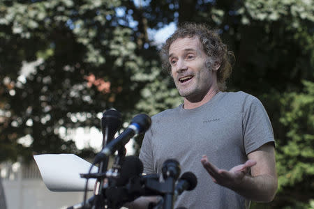 Peter Theo Curtis, who was released on Sunday from two years in the captivity of insurgents in Syria, talks to reporters near his mother's home in Cambridge, Massachusetts August 27, 2014. REUTERS/Brian Snyder