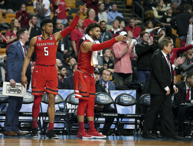 Texas Tech's Justin Gray, left, and Brandone Francis, middle, celebrate near the end of the team's NCAA men's college basketball tournament regional semifinal against Purdue, early Saturday, March 24, 2018, in Boston. (AP Photo/Mary Schwalm)