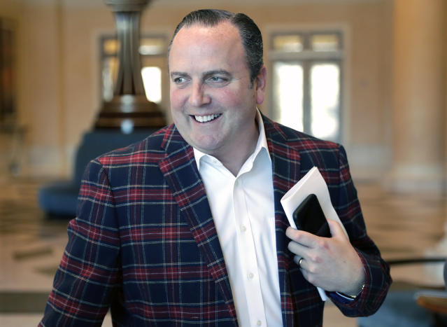 Derrick Hall, Chief Executive Officer of the Arizona Diamondbacks, greets reporters as he arrives for baseball owners meetings Thursday, Feb. 7, 2019, in Orlando, Fla. (AP Photo/John Raoux)