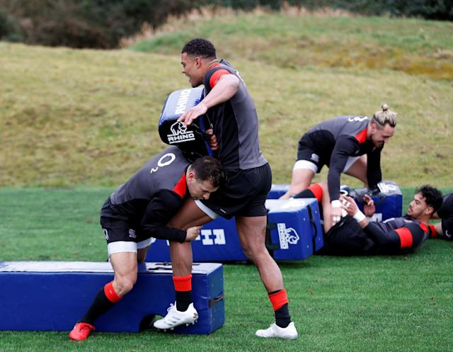 Rugby Union - England Training - Pennyhill Park, Bagshot, Britain - February 20, 2018 England's Danny Care and Nathan Earle during training Action Images via Reuters/Paul Childs