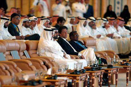 Prime Minister and Vice-President of the United Arab Emirates and ruler of Dubai Sheikh Mohammed bin Rashid al-Maktoum, Imran Khan, Prime Minister of Pakistan,Saudi Arabia Minister of State Ibrahim Abdulaziz Al-Assaf, attend the investment conference in Riyadh, Saudi Arabia October 23, 2018.  REUTERS/Faisal Al Nasser