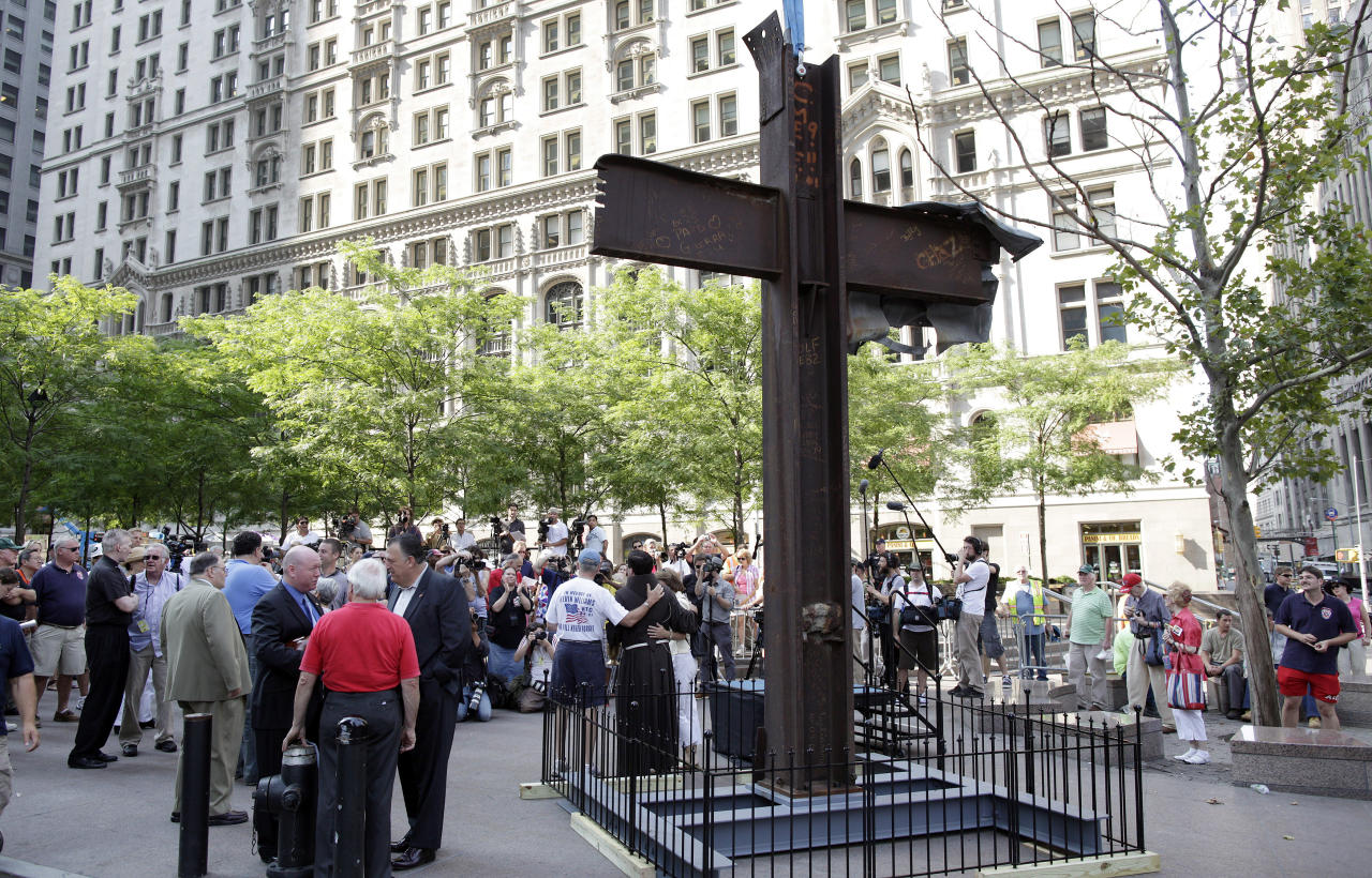 The World Trade Center Cross, made of intersecting steel beams found in the rubble of buildings destroyed in the September 11 2001 attacks on the World Trade Center, waits to be blessed by Father Brian Jordan, a Franciscan Priest, before it is transported then lifted by a crane and lowered into an opening in the World Trade Center site below ground level where it will become part of the permanent installation exhibit in the 9/11 Memorial and Museum, in New York, July 23, 2011. The 9/11 Memorial and Museum at the World Trade Center site will open on the 10 year anniversary of the attacks on September 11, 2011. (REUTERS/Chip East)