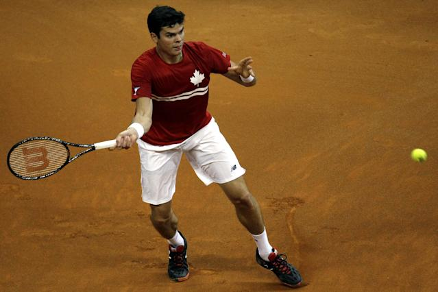 Canada's Milos Raonic returns the ball to Serbia's Janko Tipsarevic during their Davis Cup semifinals tennis match in Belgrade, Serbia, Friday, Sept. 13, 2013. (AP Photo/ Marko Drobnjakovic)