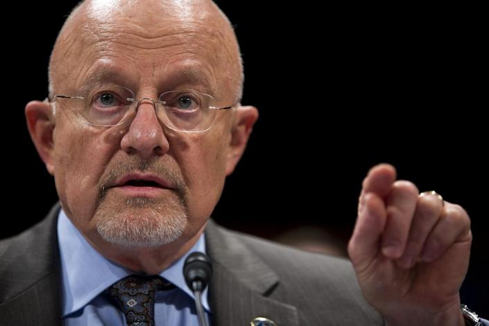 FILE - In this Oct. 29,2013 file photo, Director of National Intelligence James Clapper testifies on Capitol Hill in Washington. Clapper is declassifying more documents that show how the National Security Agency was first authorized to start collecting bulk phone and Internet records in the hunt for al-Qaida terrorists. Clapper explains in a statement on Dec. 21 that President George W. Bush first authorized the spying as part of the Terrorist Surveillance Program, just after the Sept. 11 attacks. (AP Photo/ Evan Vucci, File)