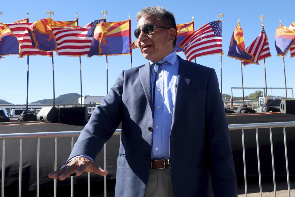 Navajo Nation President Myron Lizer speaks after a rally to support Donald Trump at the rodeo grounds in Williams, Arizona, on Oct. 15, 2020. Lizer makes no qualms about it: As one of the top officials on the country's largest Native American reservation, he's a proud Donald Trump supporter. (AP Photo/Felicia Fonseca)