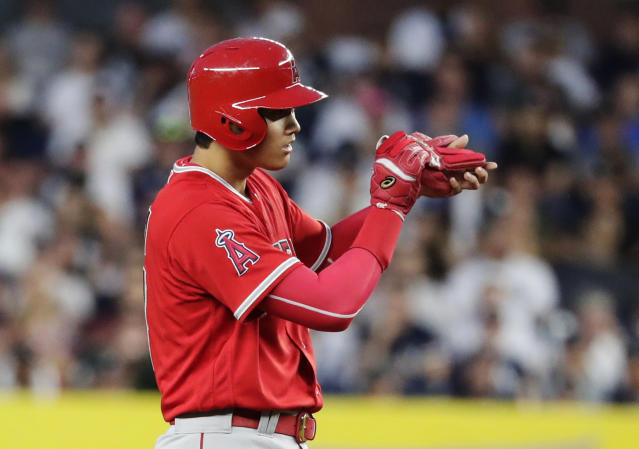 Los Angeles Angels' Shohei Ohtani, of Japan, looks inside his glove during the fourth inning of a baseball game against the New York Yankees on Friday, May 25, 2018, in New York. (AP Photo/Frank Franklin II)
