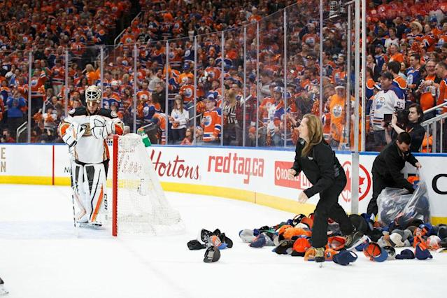 "EDMONTON, AB – MAY 7: Goalie <a class=""link rapid-noclick-resp"" href=""/nhl/players/3993/"" data-ylk=""slk:Jonathan Bernier"">Jonathan Bernier</a> #1 of the <a class=""link rapid-noclick-resp"" href=""/nhl/teams/ana/"" data-ylk=""slk:Anaheim Ducks"">Anaheim Ducks</a> looks on as attendants pick up hats after <a class=""link rapid-noclick-resp"" href=""/nhl/players/6369/"" data-ylk=""slk:Leon Draisaitl"">Leon Draisaitl</a> of the <a class=""link rapid-noclick-resp"" href=""/nhl/teams/edm/"" data-ylk=""slk:Edmonton Oilers"">Edmonton Oilers</a> (not pictured) scored a hat trick in Game Six of the Western Conference Second Round during the 2017 NHL Stanley Cup Playoffs at Rogers Place on May 7, 2017 in Edmonton, Alberta, Canada. (Photo by Codie McLachlan/Getty Images)"