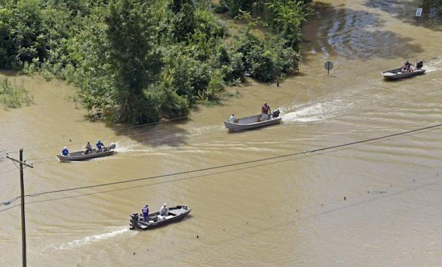 Boats sail on Highway 431, flooded after heavy rains in the Ascension Parish area, south of Baton Rouge earlier this month. (AP)
