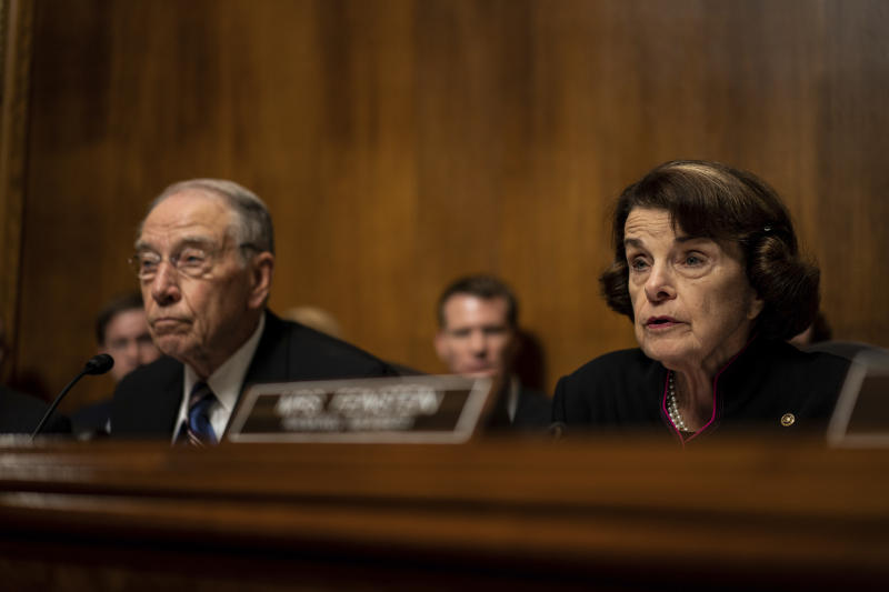 Senate Judiciary Committee Chairman Chuck Grassley, R-Iowa, and Sen. Dianne Feinstein, D-Calif., the ranking member, listen as Supreme Court nominee Brett Kavanaugh testifies before the Senate Judiciary Committee on Capitol Hill in Washington, Thursday, Sept. 27, 2018. (Erin Schaff/The New York Times via AP, Pool)
