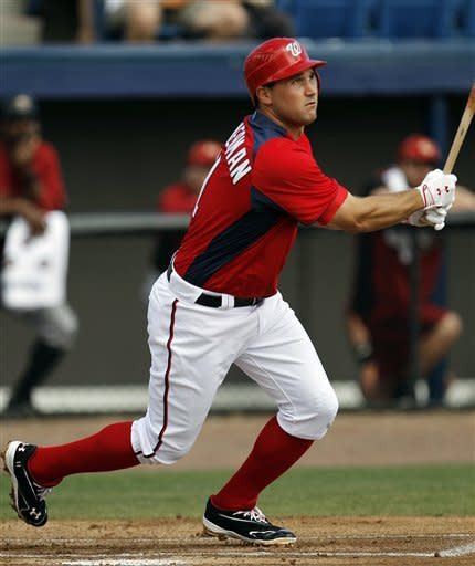 Washington Nationals third baseman Ryan Zimmerman (11) hits a solo home run against the Houston Astros in the first inning of a spring training baseball game in Viera, Fla., Thursday, March 8, 2012. (AP Photo/Paul Sancya)