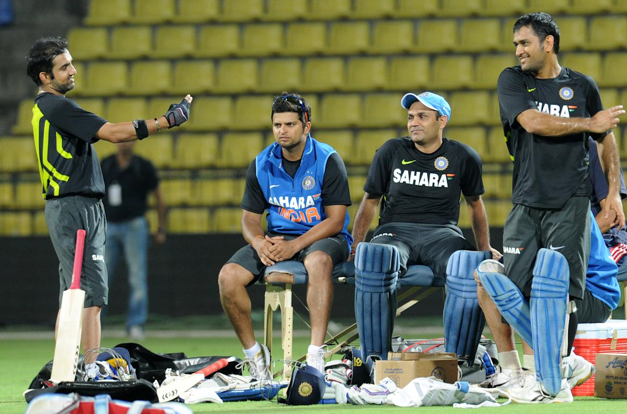 Indian cricket team captain Mahendra Singh Dhoni (R), Virender Sehwag (2R), Suresh Raina (2L), and Gautam Gambhir (L) interact during a practice session at the Pallekele International Cricket Stadium in Pallekele on August 3, 2012. India leads Sri Lanka 3-1 in the five match series as they meet for the fifth and final one-day international (ODI) in Pallekele on August 4. AFP PHOTO/ Ishara S.KODIKARA