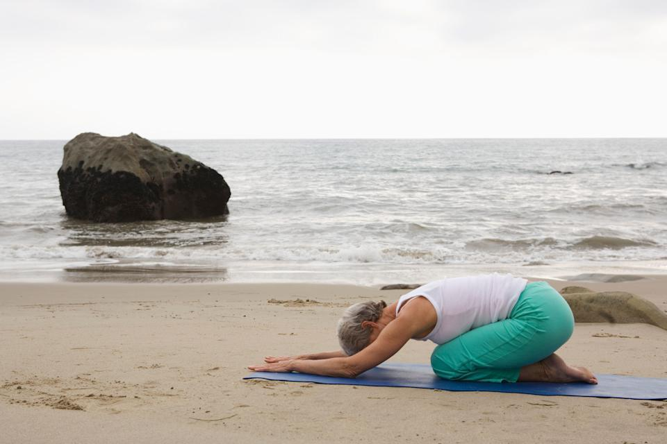 """""""Child's pose helps us turn inside and slow our minds down,"""" Virayoga founder Elena Brower recently <a href=""""http://www.huffingtonpost.com/2013/05/19/yoga-for-anxiety-10-poses_n_3281986.html#slide=2455747"""" target=""""_blank"""">told The Huffington Post</a>.  The foundational resting pose in many yoga classes, the soothing Child's Pose can help put the mind at ease while also gently opening up the back, hips and shoulders, according to Bielkus.  Sit down with your legs folded beneath you, toes touching and knees spread apart from each other. Drape your chest down between your thighs, bringing your forehead to the floor and either extending the arms out in front of you or resting them by your sides. Breathe deeply and rest in the pose for as long as desired."""