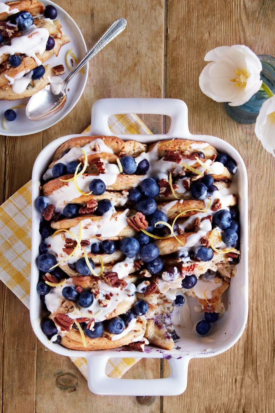 """<p>Why not made a mouthwatering Mother's Day breakfast that doubles as dessert? It's a holiday, after all. This decadent bread pudding is made with pancakes packed with blueberries and pecans.</p><p><strong><a href=""""https://www.countryliving.com/food-drinks/recipes/a37601/blueberry-pecan-pancake-bread-pudding/"""" rel=""""nofollow noopener"""" target=""""_blank"""" data-ylk=""""slk:Get the recipe"""" class=""""link rapid-noclick-resp"""">Get the recipe</a>.</strong></p><p><a class=""""link rapid-noclick-resp"""" href=""""https://www.amazon.com/Presto-Cool-Touch-Electric-Ceramic-Griddle/dp/B01G7DM6VE?tag=syn-yahoo-20&ascsubtag=%5Bartid%7C10050.g.1681%5Bsrc%7Cyahoo-us"""" rel=""""nofollow noopener"""" target=""""_blank"""" data-ylk=""""slk:SHOP GRIDDLES"""">SHOP GRIDDLES</a> </p>"""