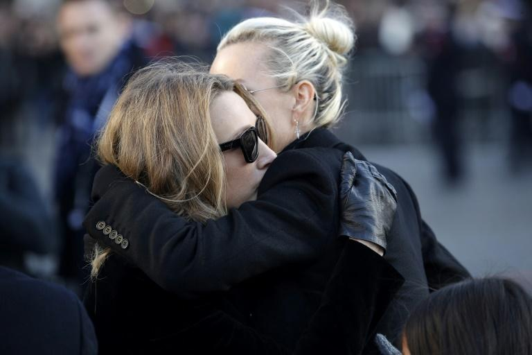 Laeticia Hallyday, pictured right, and Laura Smet, pictured left, had appeared to put on a united front at Johnny Hallyday's funeral