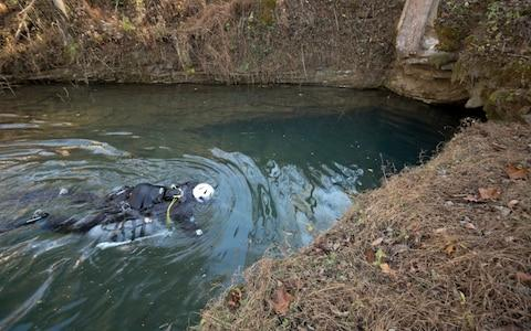 Emergency services at the scene where Josh Bratchley, diver who helped free Thai soccer team, was rescued from Tennessee cave