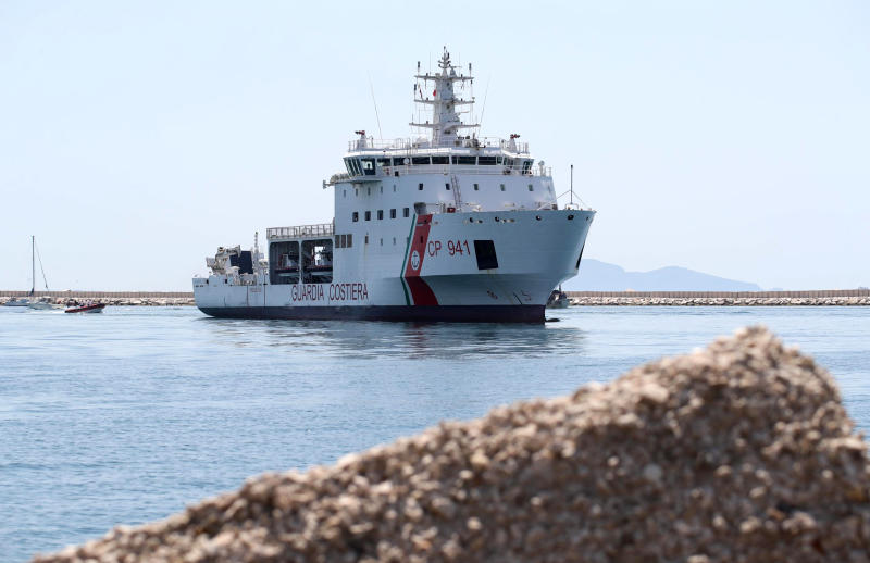 The Diciotti ship of the Italian Coast Guard, with 67 migrants on board rescued 4 days ago by the Vos Thalassa freighter, enters the Sicilian port of Trapani, southern Italy, Thursday, July 12, 2018. The top security officials of Germany, Italy and Austria are touting their hard line on migration issues, saying Europe needs to protect its exterior borders and crack down on human smuggling. (Igor Petyx/ANSA via AP)