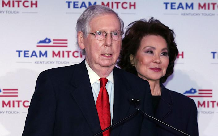 Mitch McConnell is joined by his wife, Elaine Chao, as he speaks at a press conference in Kentucky - Mark Lyons/Shutterstock
