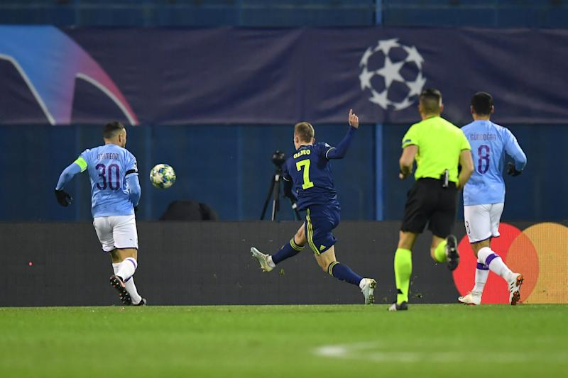 ZAGREB, CROATIA - DECEMBER 11: Dani Olmo of GNK Dinamo Zagreb scores his team's first goal past Nicolas Otamendi of Manchester City during the UEFA Champions League group C match between Dinamo Zagreb and Manchester City at Maksimir Stadium on December 11, 2019 in Zagreb, Croatia. (Photo by Dan Mullan/Getty Images)