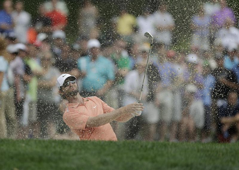 Kyle Stanley hits out of a bunker on the 11th fairway during the final round of the Memorial golf tournament on Sunday, June 2, 2013, in Dublin, Ohio. (AP Photo/Darron Cummings)