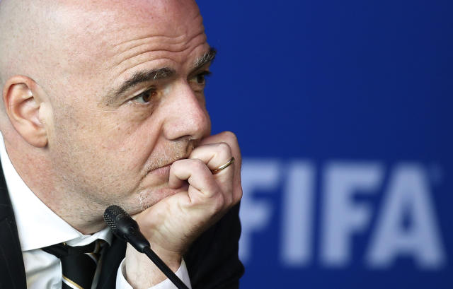 FIFA President Gianni Infantino listens to a reporter's question during a press conference after the FIFA Council Meeting, in Bogota, Colombia, Friday, March, 16, 2018. FIFA has finally and fully approved video review to help referees at the World Cup. The last step toward giving match officials high-tech help in Russia was agreed to on Friday by FIFA's ruling council chaired by Infantino. (AP Photo/Fernando Vergara)