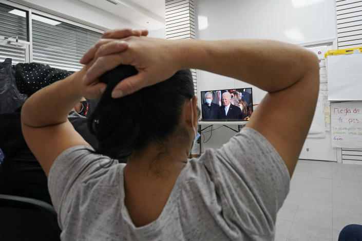 Graciela Uraga, a cleaning lady, watches President Joe Biden's inauguration with other immigrants at the Workers Justice Center, Wednesday, Jan. 20, 2021, in the Sunset Park neighborhood of Brooklyn in New York. (AP Photo/Kathy Willens)