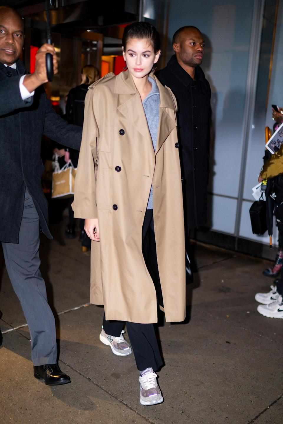 Trench coats work with sneakers just as well as boots.