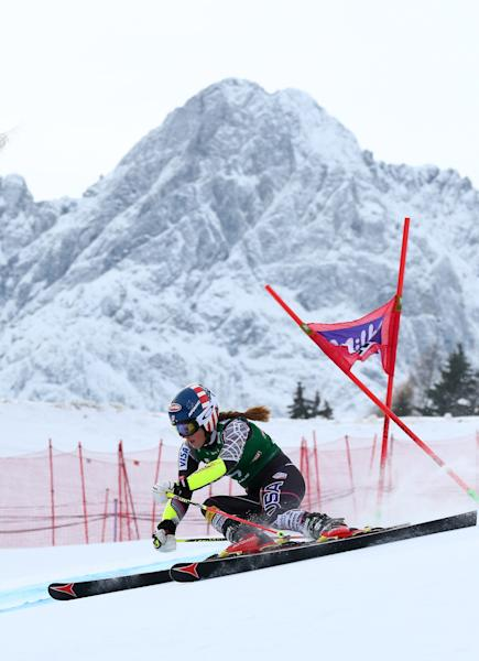 Mikaela Shiffrin, of the US, speeds down the course during the first run of an alpine ski, women's World Cup giant slalom, in Lienz, Austria, Saturday, Dec. 28, 2013. (AP Photo/Giovanni Auletta)