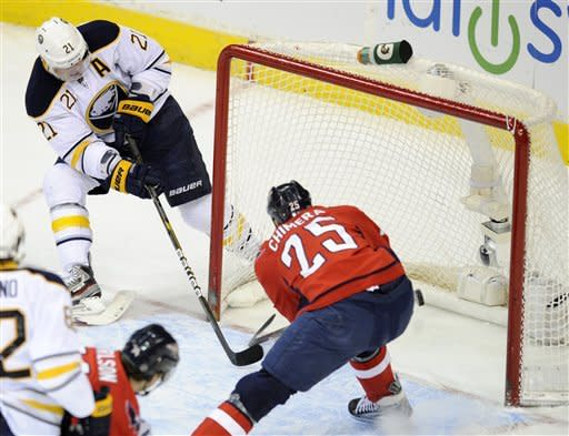 Buffalo Sabres right wing Drew Stafford (21) scores a goal against Washington Capitals left wing Jason Chimera (25) during the first period of an NHL hockey game, Tuesday, March 27, 2012, in Washington. (AP Photo/Nick Wass)