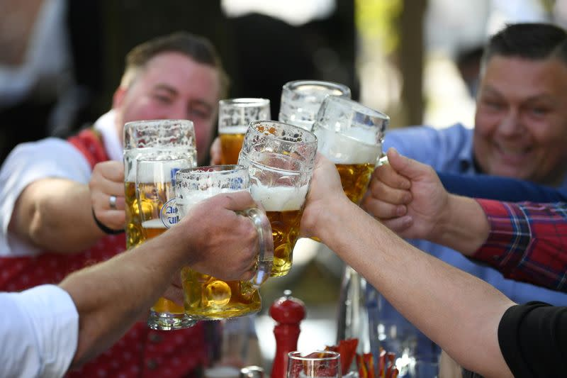 FILE PHOTO: Beer garden guests salute near Theresienwiese where Oktoberfest would have started