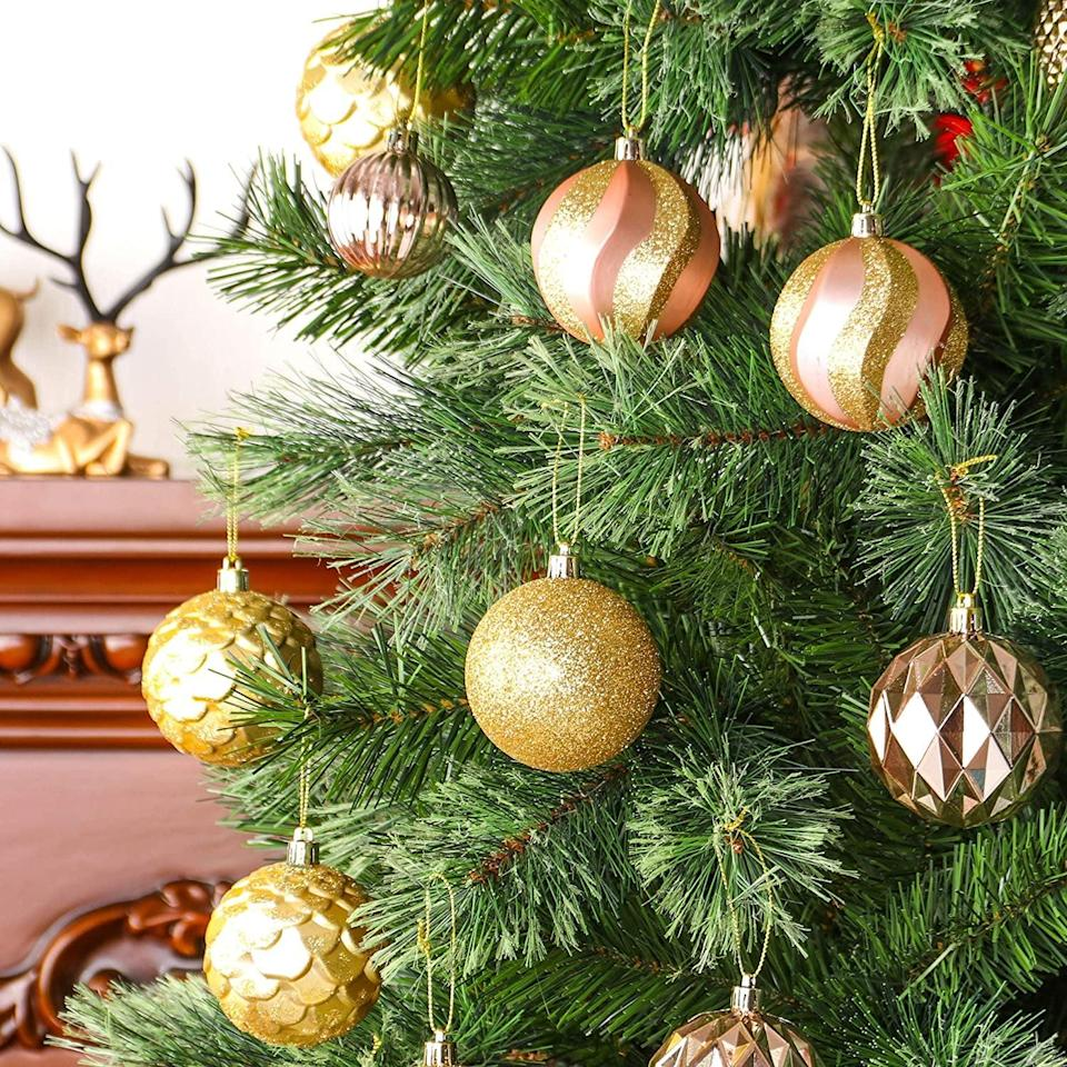 <p>This set of <span>31 pcs 70mm & 50mm Christmas Decoration Balls</span> ($19) features stunning ornaments of all different sizes, patterns, and textures. </p>
