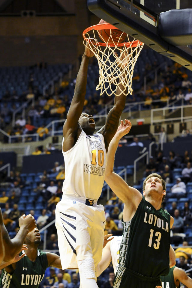 West Virginia's Eron Harris (10) tips in a basket during the first half of an NCAA college basketball game against Loyola Maryland, Monday, Dec. 2, 2013, in Morgantown, W.Va. (AP Photo/Andrew Ferguson)