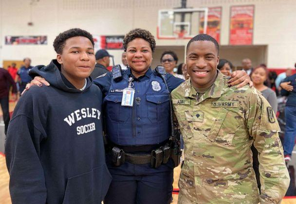 PHOTO: Officer Williamson, center, poses with her sons Justin Patillo, left, and Shakir Aquil (Jasmine Mosley/Atlanta Public Schools)