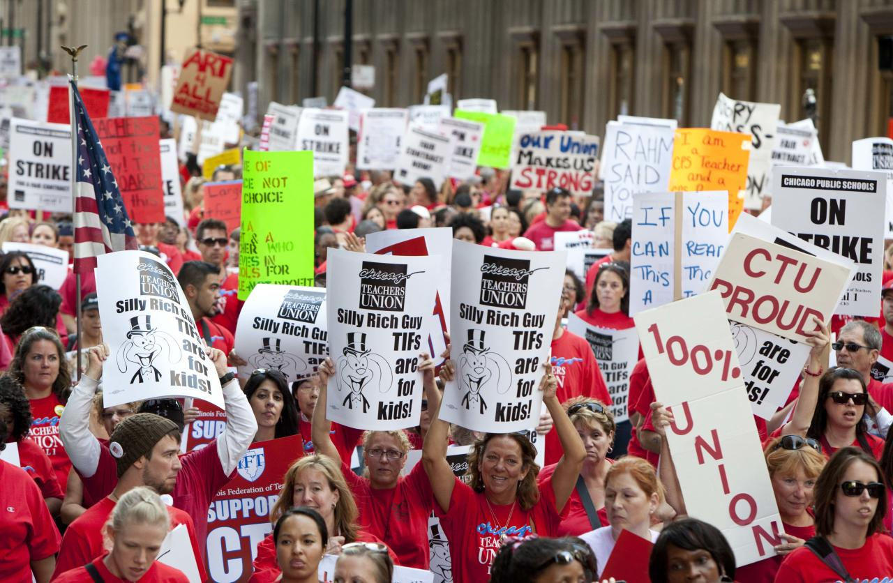 Thousands of public school teachers march for the second consecutive day on Tuesday, Sept. 11, 2012 in downtown Chicago. Teachers walked off the job Monday for the first time in 25 years over issues that include pay raises, classroom conditions, job security and teacher evaluations. (AP Photo/Sitthixay Ditthavong)