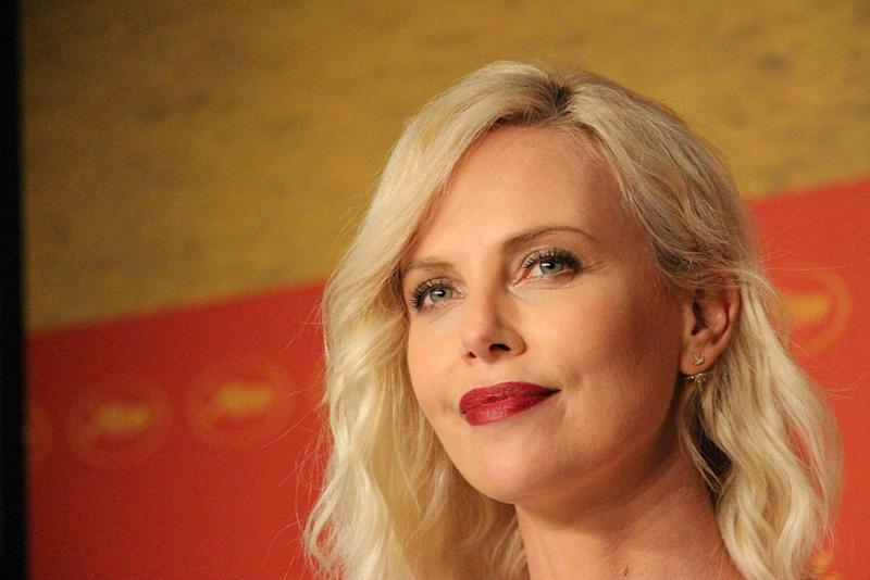 Charlize Theron is a vision in gold in new Dior perfume ad