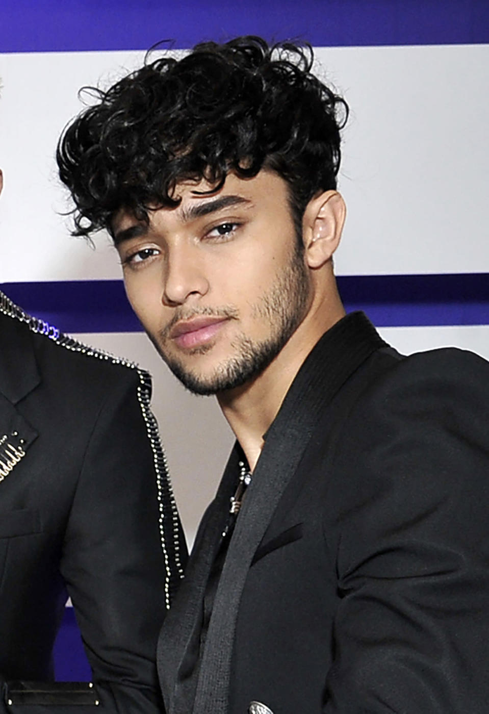 File - This Oct. 17, 2019, file photo shows Joel Pimentel, of CNCO, posing backstage at the Latin American Music Awards in Los Angeles. The Latin American boy band CNCO is downsizing. The group announced on its official Instagram page Sunday, May 9, 2021, that 22-year-old Pimentel is leaving the band, making the successful quintet a quartet. (Photo by Richard Shotwell/Invision/AP, File)