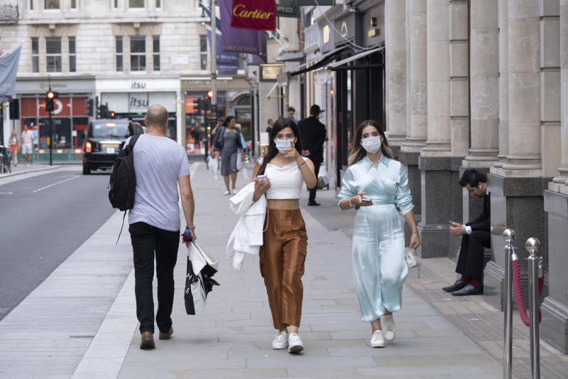 As Britain enters a period of deep recession, as the economic downturn caused by the Covid-19 pandemic cuts, shoppers wearing face masks continue to come to the West End to the exclusive high end fashion shops on Bond Street on 13th August 2020 in London, United Kingdom. The Office for National Statistics / ONS has announced that gross domestic product / GDP, the widest gauge of economic health, fell by 20.4% in the second quarter of the year, compared with the previous quarter. This is the biggest decline since records began. The result is that Britain has officially entered recession, as the UK economy shrank more than any other major economy during the coronavirus outbreak. (photo by Mike Kemp/In PIctures via Getty Images)